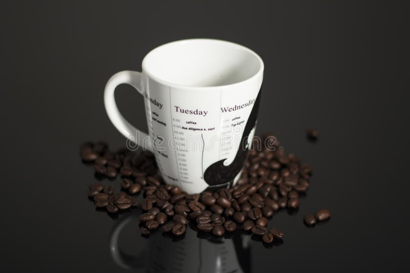 Coffee mug and coffee beans stock photo