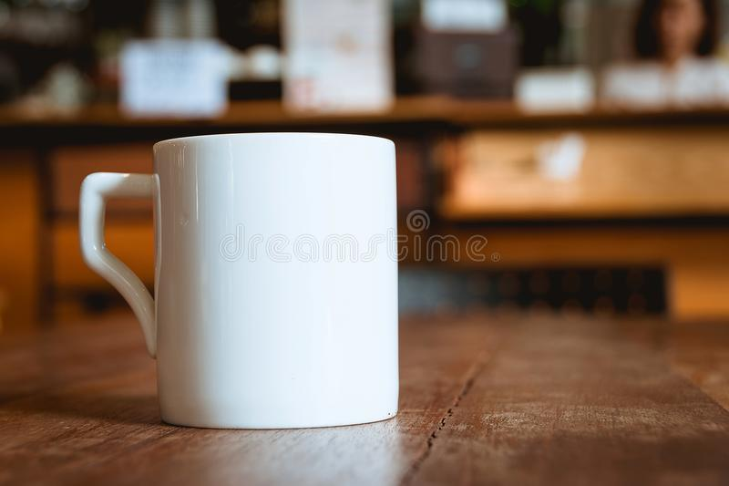 Coffee mug in coffee shop cafe.  royalty free stock photography