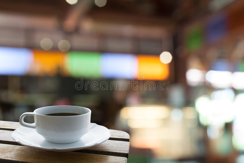 Coffee mug in coffee shop cafe. Coffee mug on table in coffee shop cafe royalty free stock photo