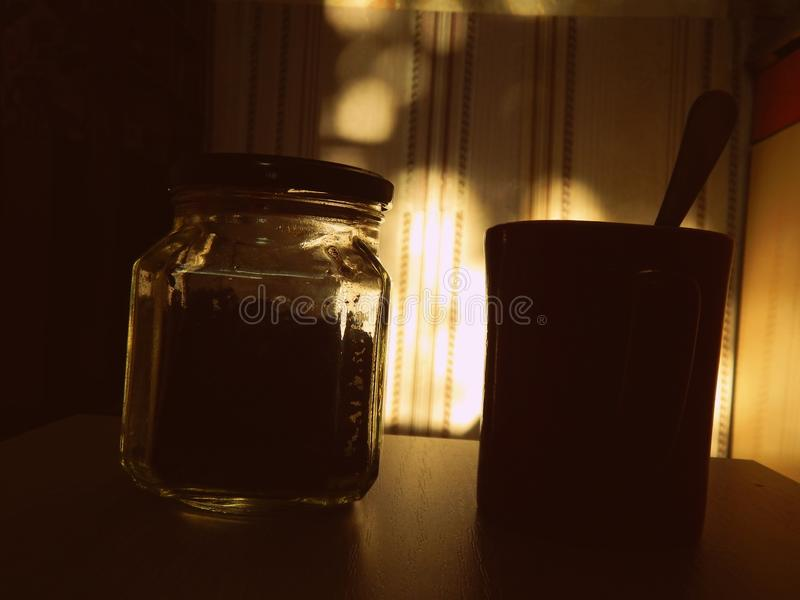 Coffee and mug in a dark room royalty free stock images