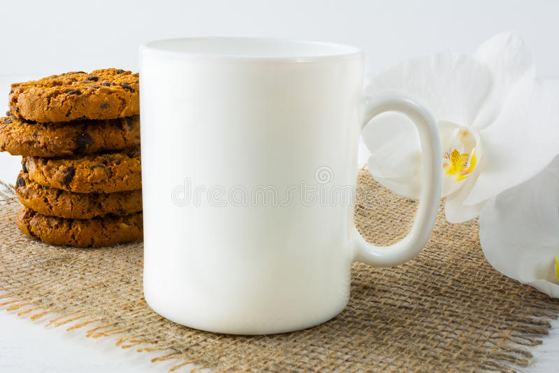 Coffee mug mockup with cookies stock image