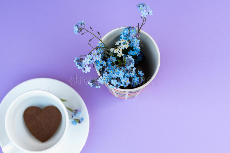 Coffee mug on a purple background. background Breakfast, drinks and cafe menu concept - coffee cup on purple background, toplay. Flatlay. cookies to coffee stock photos