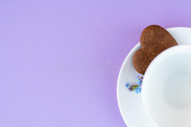 Coffee mug on a purple background. background Breakfast, drinks and cafe menu concept - coffee cup on purple background, toplay. Flatlay. cookies to coffee royalty free stock photos