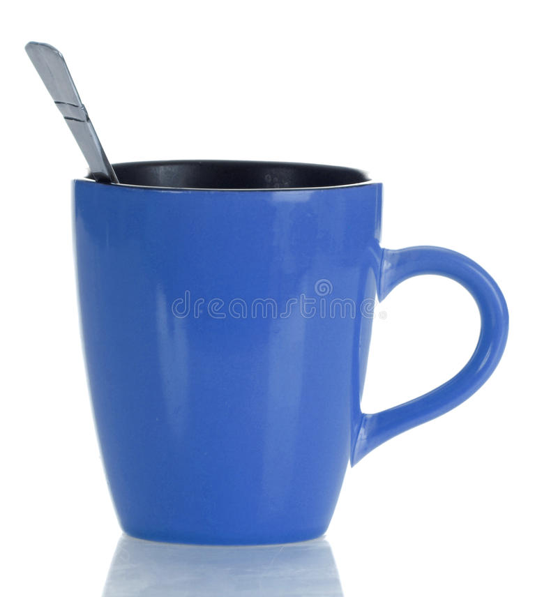 Coffee mug with spoon royalty free stock images