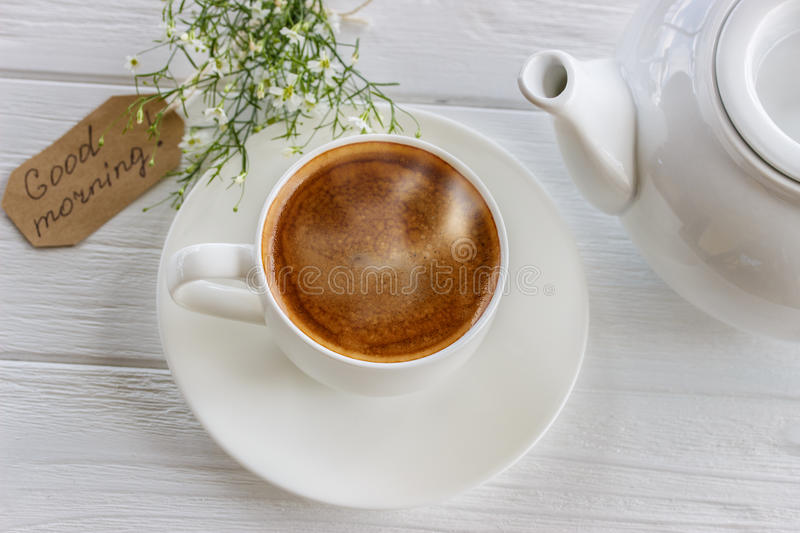 Coffee mug on white rustic table from above royalty free stock images