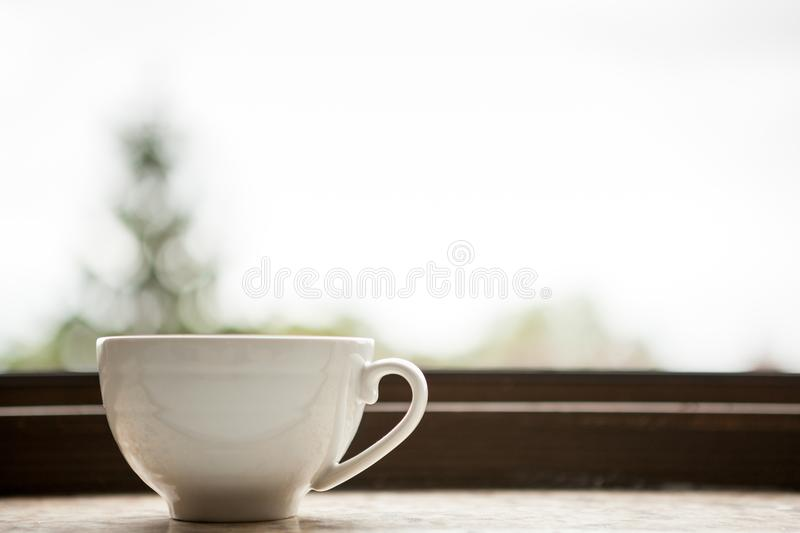 Coffee mug on a window sill. Morning coffee royalty free stock images