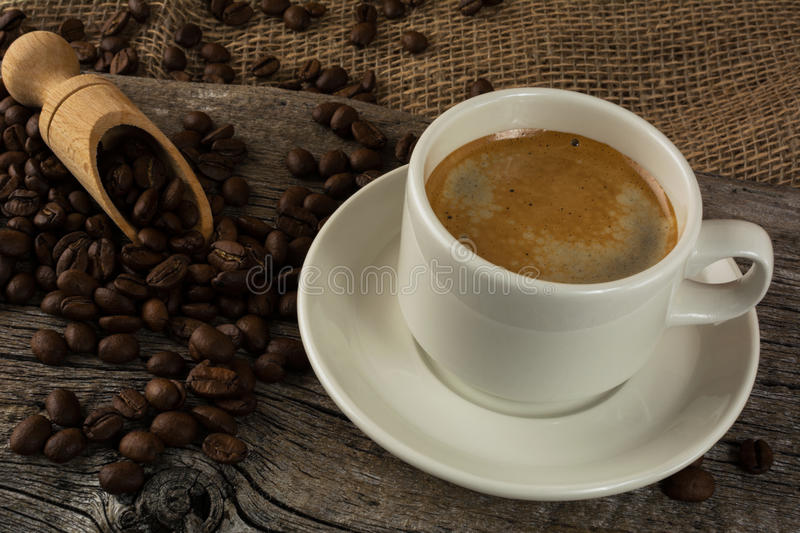 Coffee mug on the wooden background stock images