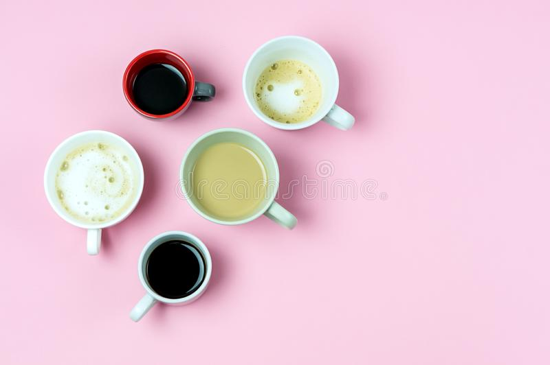Coffee Multiple Assorted Types of Coffee in Mugs Trandy Cofee Concept Pink Background Espresso Capuccino Coffee with Milk stock image