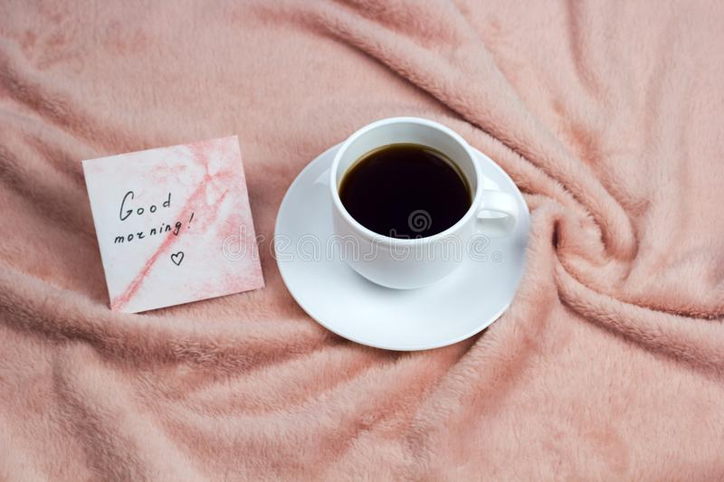 Coffee and note good morning. Hot drink and note good morning, breakfast in bed royalty free stock photography