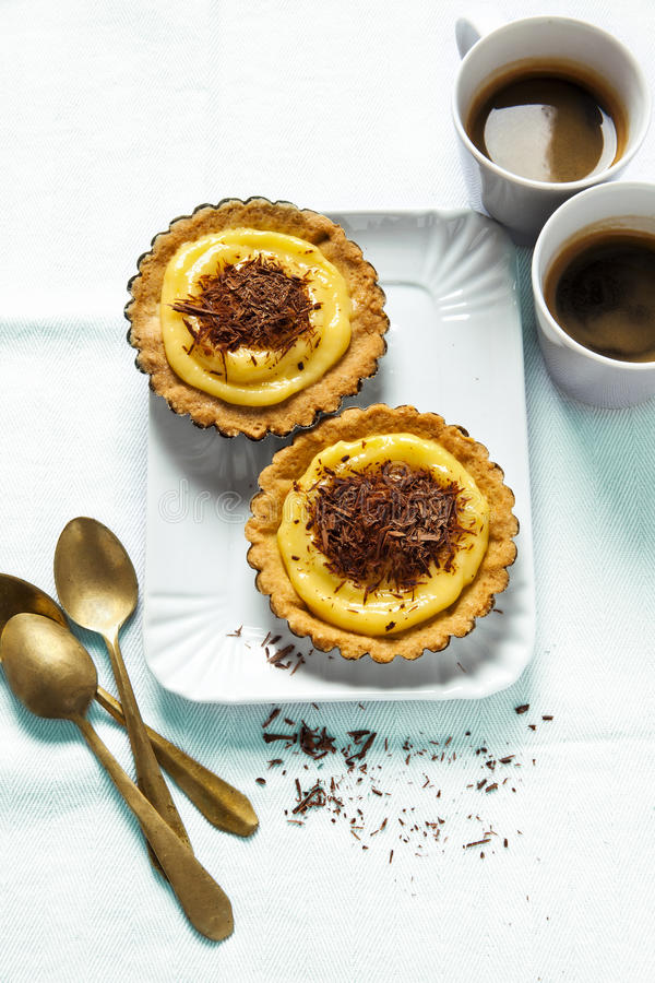 Coffee and pastries. Mini tart with lemon curd and chocolate . h. Ealthy breakfast. vegetarian food stock photos