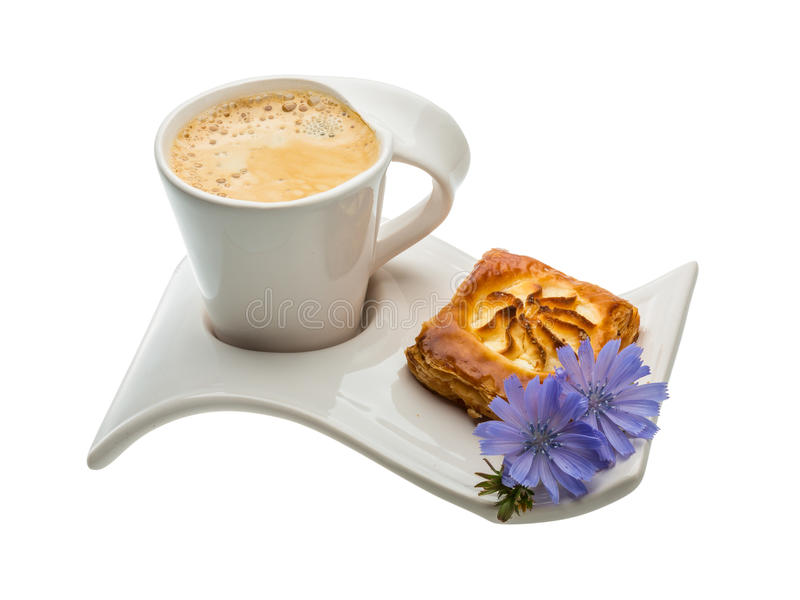 Coffee with pastry. And blue flower stock photos