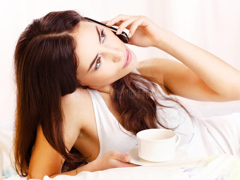 Download Coffee and phone in bed stock image. Image of indoors - 23260669