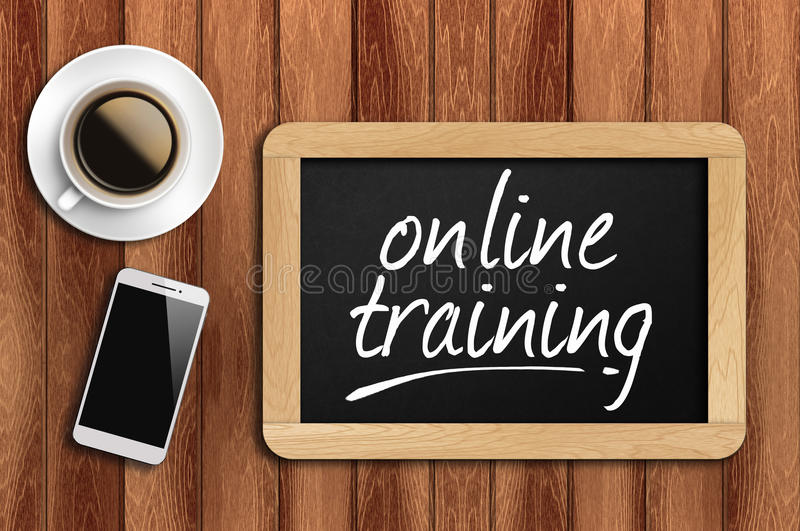Coffee, phone and chalkboard with online training words stock images