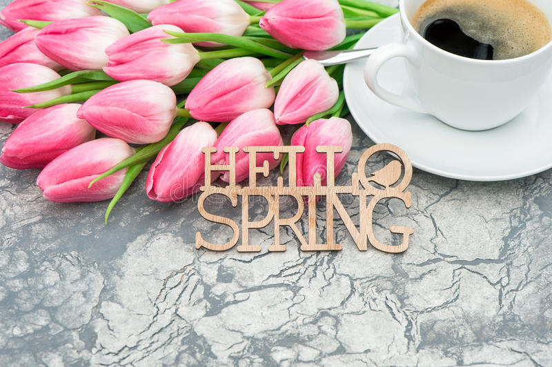 Coffee pink tulip flowers Hello spring royalty free stock photo