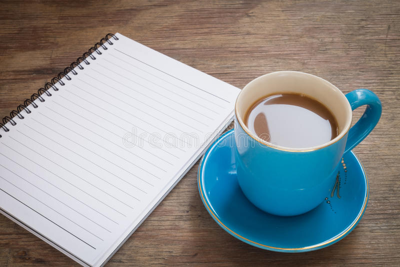 Coffee placed on a wooden floor stock image
