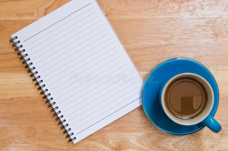 Coffee placed on a wooden floor royalty free stock images