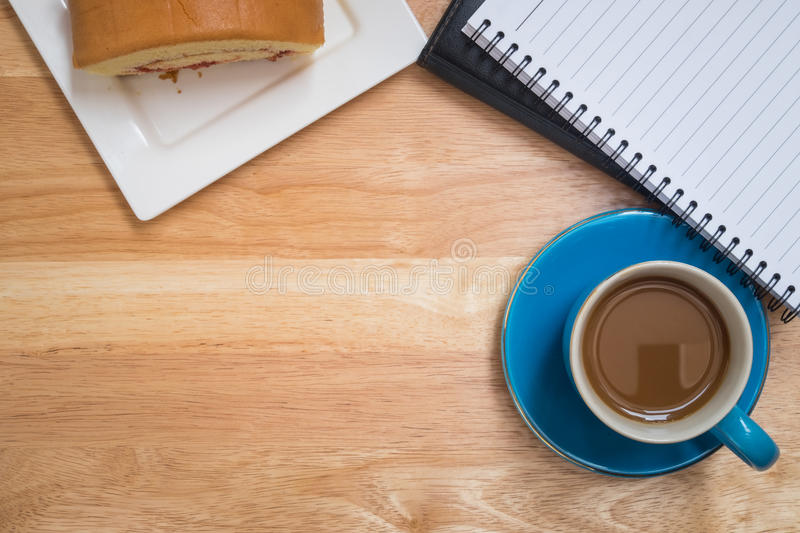 Coffee placed on a wooden floor stock photography