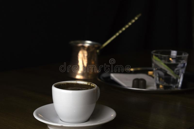 coffee pot with a cup of coffee and chocolate stock photography