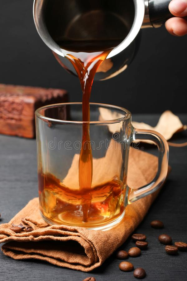 Coffee poured in glass royalty free stock photo