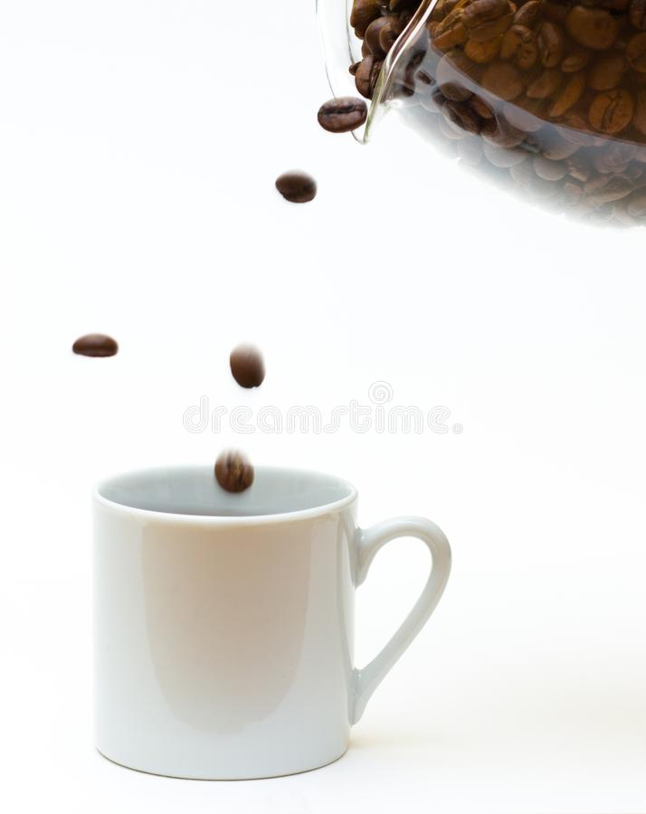 Coffee pouring into a cup royalty free stock photos