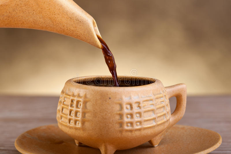 Coffee pouring into cup royalty free stock photo