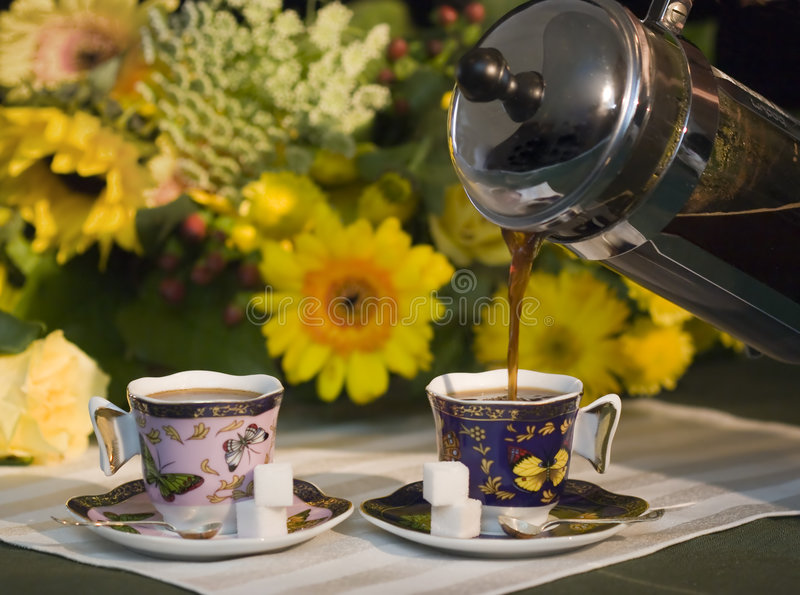 Coffee pouring into cups royalty free stock photography