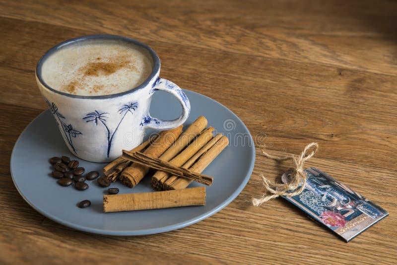 Coffee, roast beans and cinnamon sticks. royalty free stock image