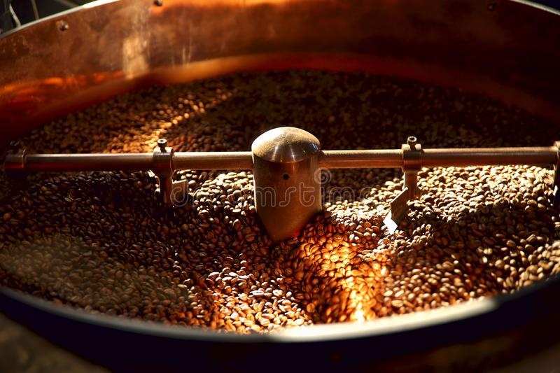 Coffee roasting machine. Coffee beans in the chafing dish. Shot cropped, horizontal, background. The concept of production and industryn stock photo