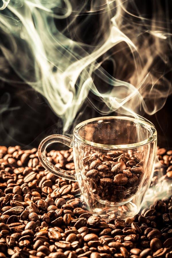Coffee sack full of aroma roasted seeds stock image
