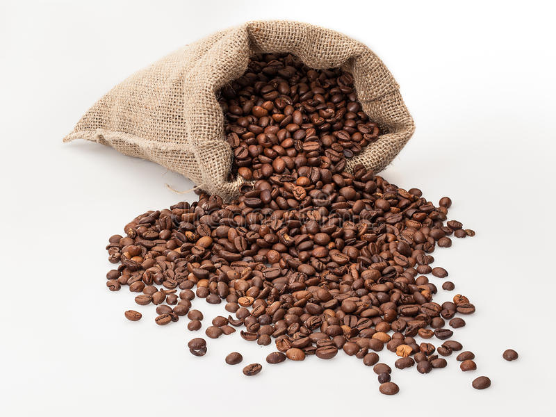 Coffee sack with scattered beans royalty free stock photos