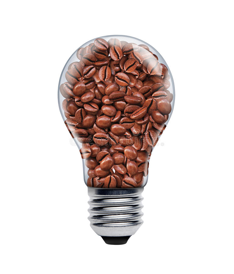 Coffee seeds in a light bulb stock image