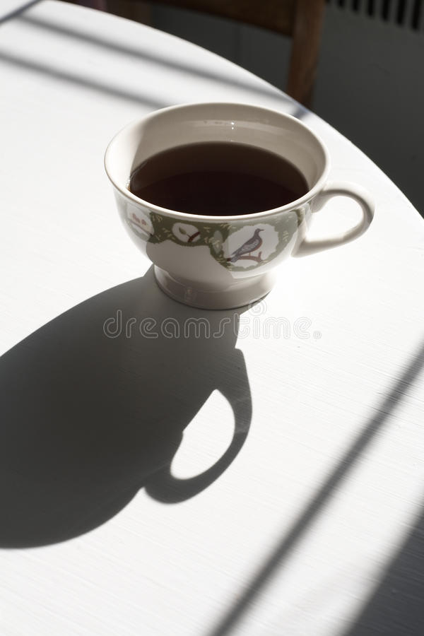 Coffee and shadow royalty free stock photos