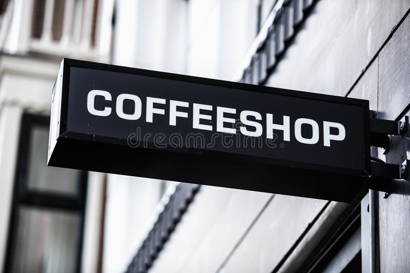 Coffee shop banner on entrance in Amsterdam. Coffeeshop in Amsterdam.Signboard on building with bar that sell legal marijuana for tourists.Buy legalized weed in stock photo