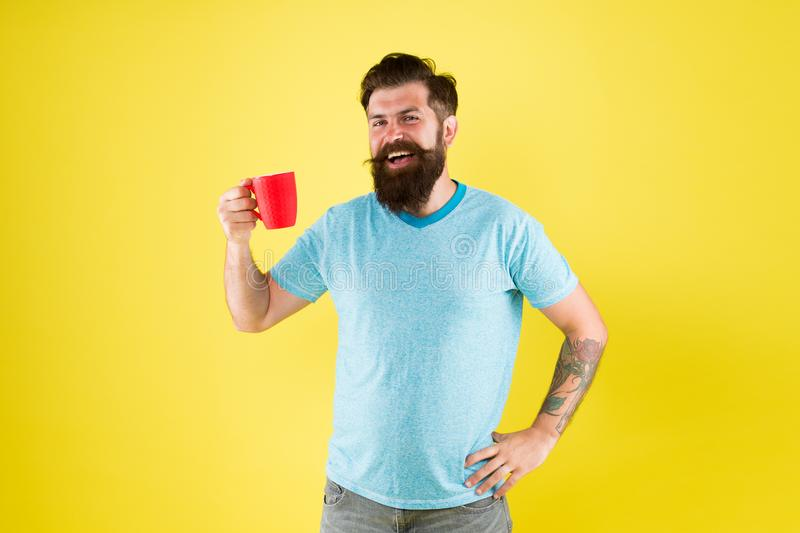 Coffee shop. Bearded man drink morning coffee. Tea time. Cappuccino with right proportion of milk. True specialty coffee stock photo