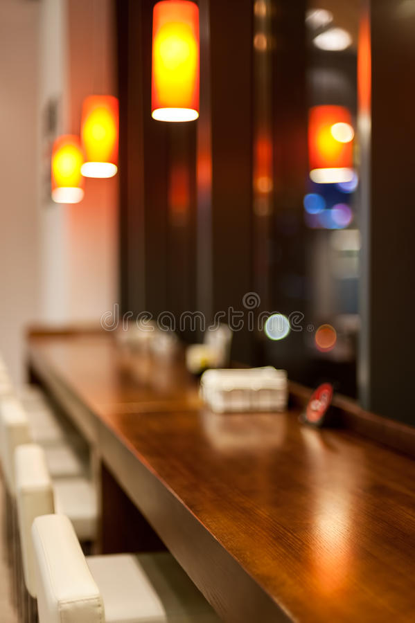 Coffee shop blur. Background with bokeh royalty free stock photography