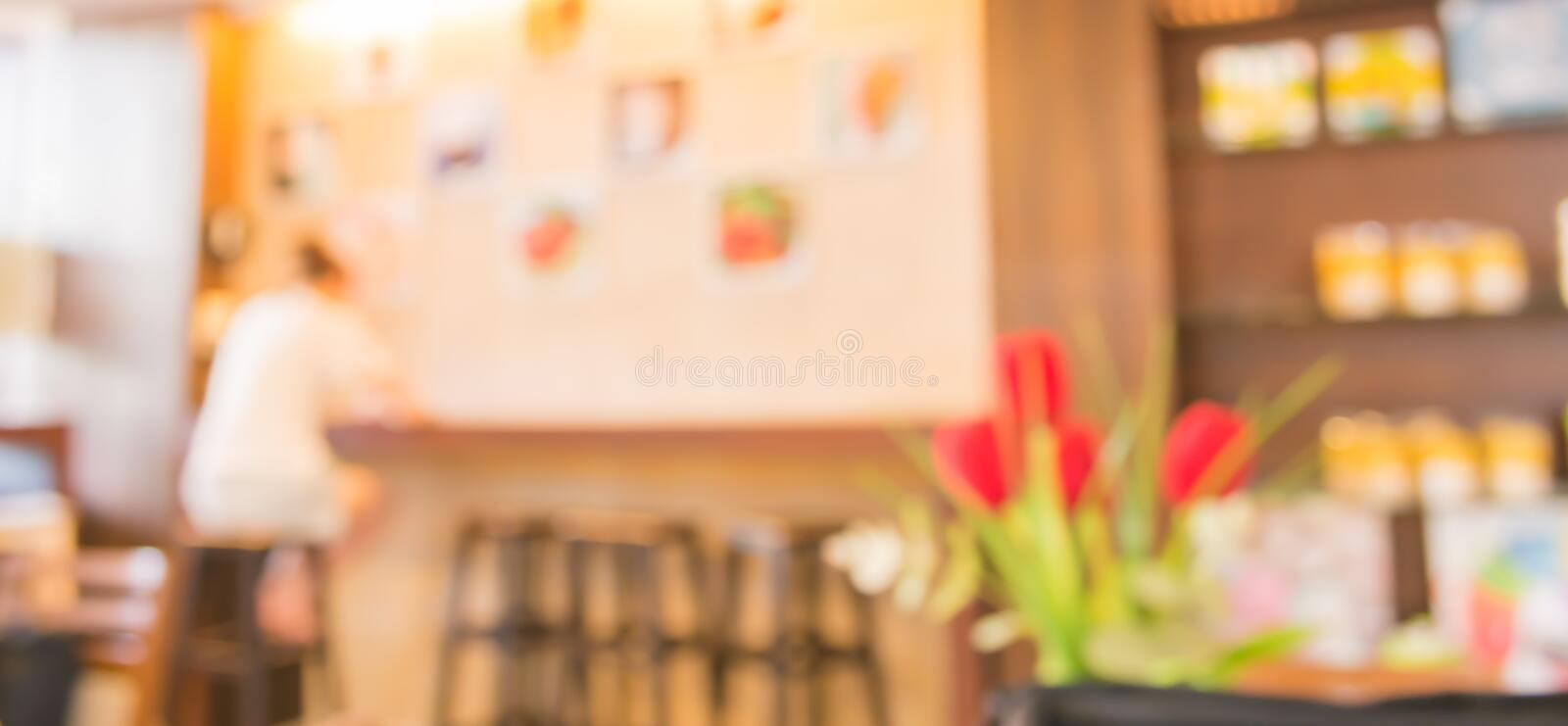Coffee shop blur background with bokeh image . royalty free stock photos