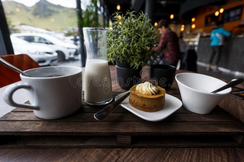 Coffee Shop Edibles. View of coffee, milk, cheesecake, and sugar. Use for titles, backgrounds, small business royalty free stock photos