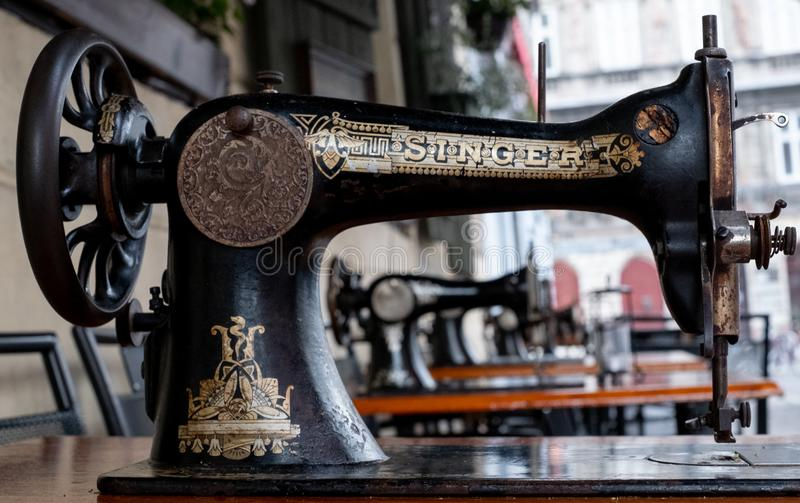 Coffee shop in Kazmierz, the historic Jewish quarter of Krakow, with Singer sewing machines on the tables. Coffee shop in Kazmierz, the historic Jewish quarter stock image