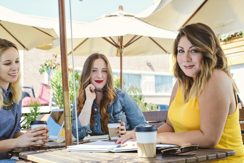 Coffee Shop Meeting with Three Young Millennial Women royalty free stock images