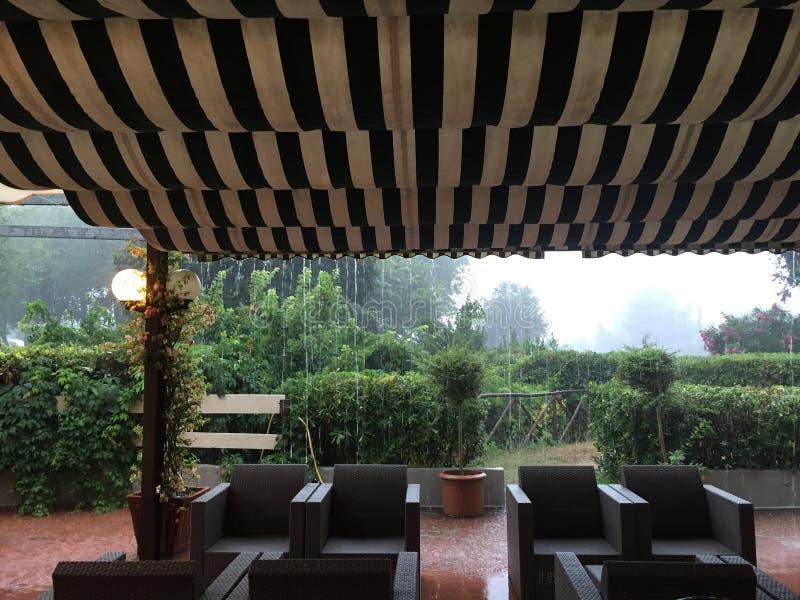 Coffee shop and rain stock image