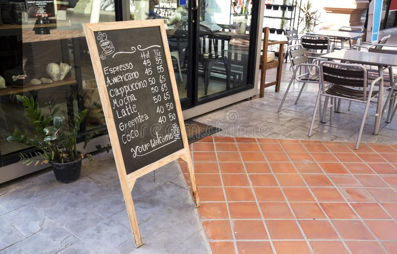 Coffee Shop and restaurant with black board show item and seating stock photography