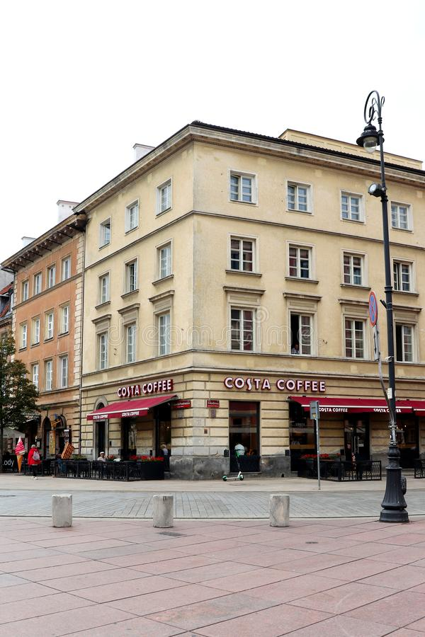 A coffee shop on a street corner in Warsaw, Poland. A coffee shop, Costa Coffee, on a street corner near Old Town in.Warsaw, Poland on a hot summer day in July royalty free stock photo