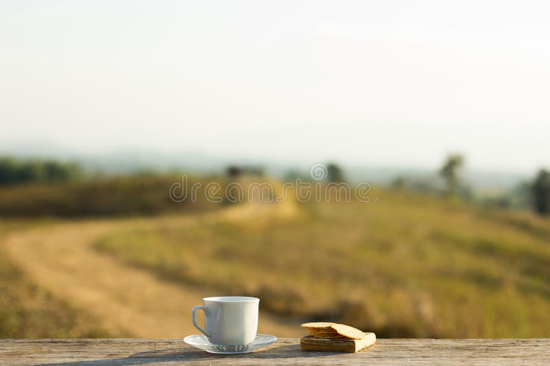 Coffee with snacks meadows as a backdrop, Place the camera with stock photo