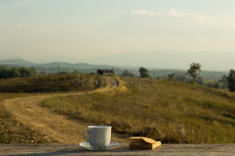 Coffee with snacks meadows as a backdrop, Place the camera with royalty free stock photos