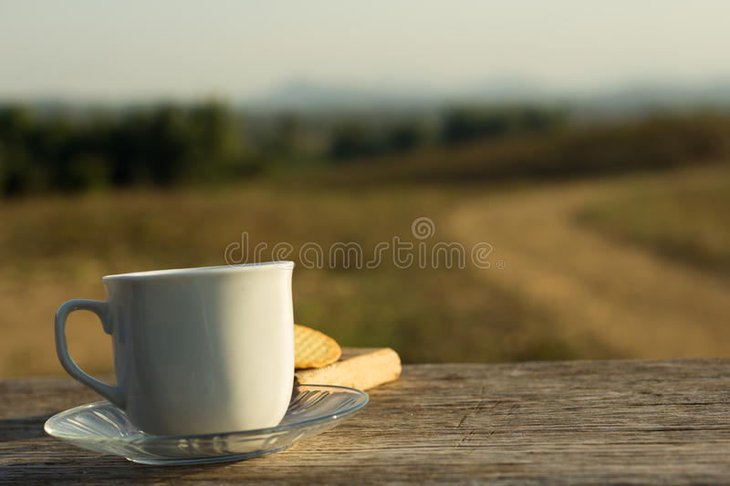 Coffee with snacks meadows as a backdrop, Place the camera with royalty free stock image