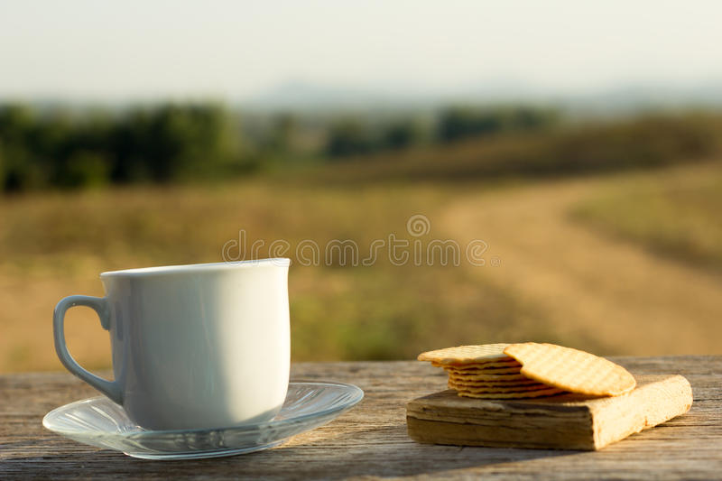Coffee with snacks meadows as a backdrop, Place the camera with stock photography