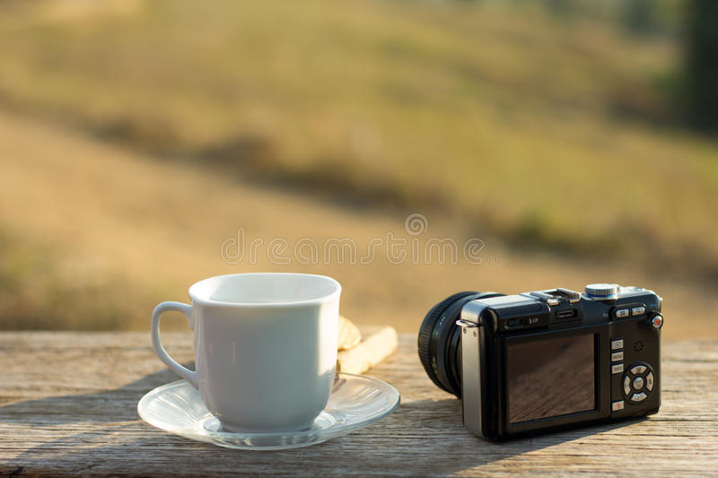 Coffee with snacks meadows as a backdrop, Place the camera with stock images