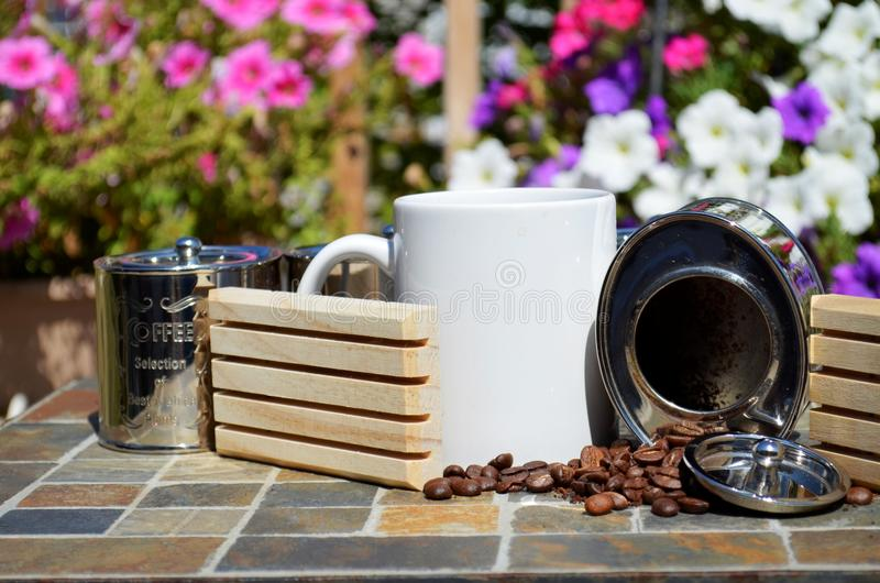 Coffee and spilled coffee beans stock images