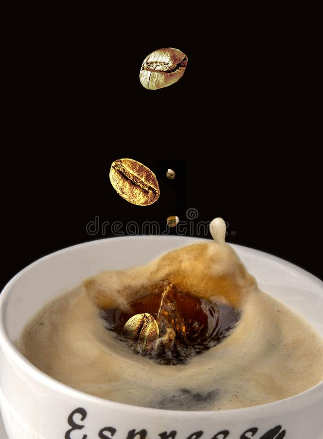 Coffee splash food art. Several big golden coffee beans, splash and crash into each other royalty free stock images