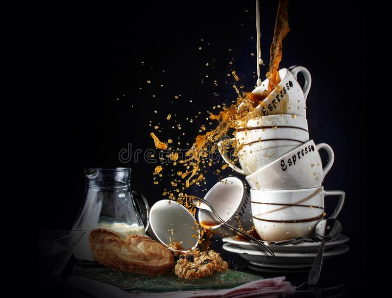Coffee splash food art. Several coffee cups, splash and crash into each other royalty free stock image